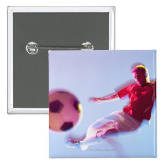 Blurred view of soccer player kicking ball 15 cm square badge