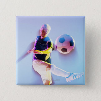 Blurred view of soccer player kicking ball 2 15 cm square badge