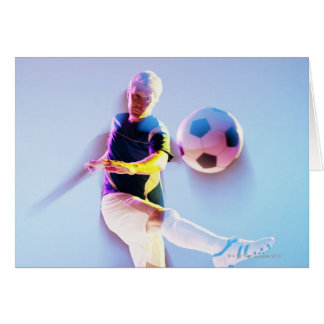 Blurred view of soccer player kicking ball 2 card