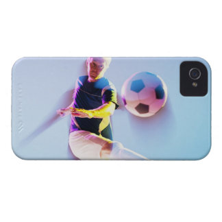 Blurred view of soccer player kicking ball 2 iPhone 4 case
