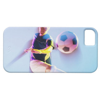 Blurred view of soccer player kicking ball 2 iPhone 5 case