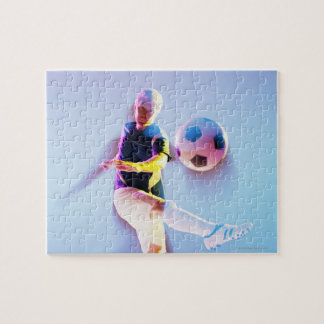 Blurred view of soccer player kicking ball 2 puzzle