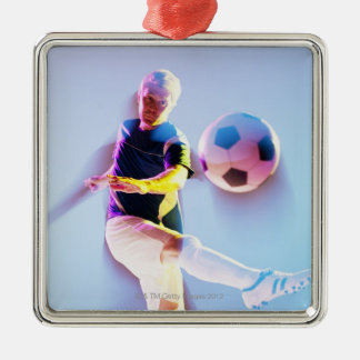 Blurred view of soccer player kicking ball 2 Silver-Colored square decoration