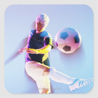 Blurred view of soccer player kicking ball 2 square sticker