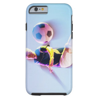 Blurred view of soccer player kicking ball 2 tough iPhone 6 case