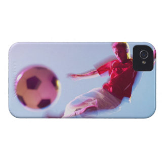 Blurred view of soccer player kicking ball Case-Mate iPhone 4 cases