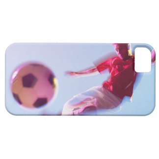 Blurred view of soccer player kicking ball iPhone 5 cover