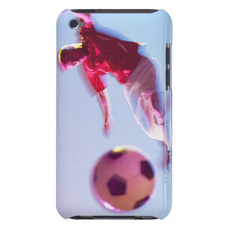 Blurred view of soccer player kicking ball iPod touch covers
