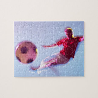 Blurred view of soccer player kicking ball jigsaw puzzle