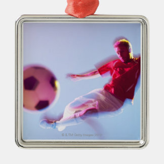 Blurred view of soccer player kicking ball Silver-Colored square decoration