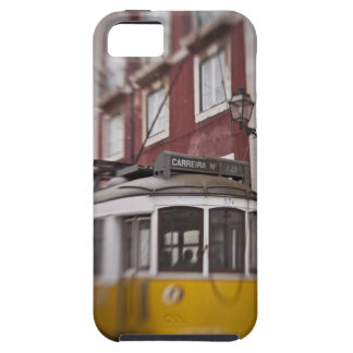 Blurred view of streetcar on city street iPhone 5 covers