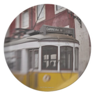 Blurred view of streetcar on city street plate