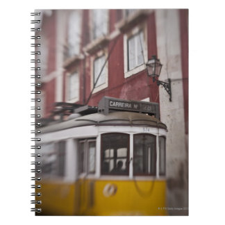 Blurred view of streetcar on city street spiral notebook