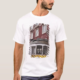 Blurred view of streetcar on city street T-Shirt