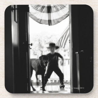 Blurred young boy and dog on porch coaster