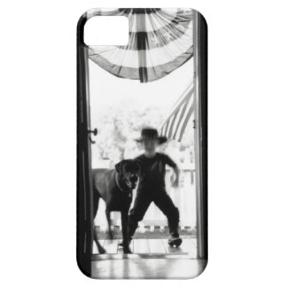 Blurred young boy and dog on porch iPhone 5 case
