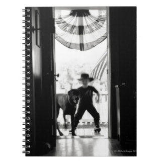 Blurred young boy and dog on porch notebook