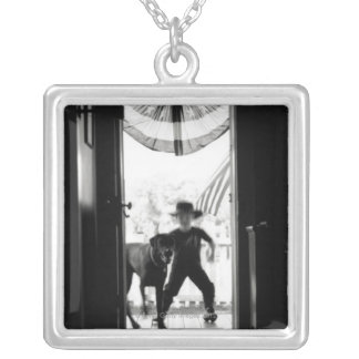 Blurred young boy and dog on porch silver plated necklace