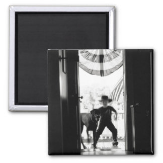 Blurred young boy and dog on porch square magnet