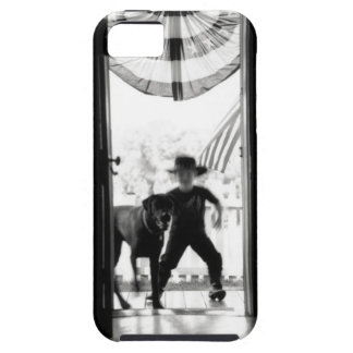 Blurred young boy and dog on porch tough iPhone 5 case