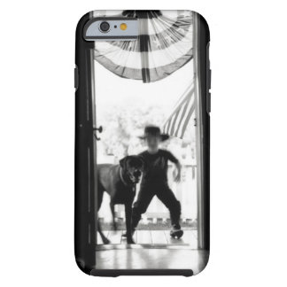 Blurred young boy and dog on porch tough iPhone 6 case