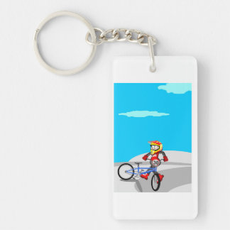 BMX young cycling making pirouettes in the incline Key Ring