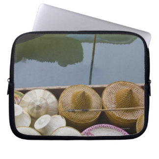 Boat loaded with bamboo hats at floating market laptop sleeve