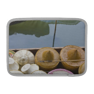 Boat loaded with bamboo hats at floating market MacBook sleeve