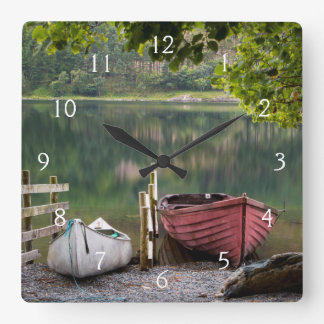 Boats along the shore of Buttermere Lake Square Wall Clock