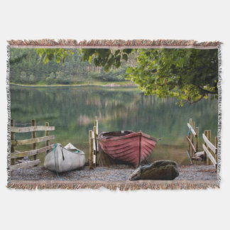 Boats along the shore of Buttermere Lake Throw Blanket