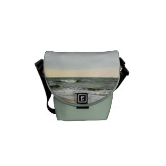 Boats and surge from the border of the beach commuter bag