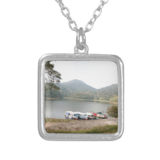 Boats at shore of a lake necklaces