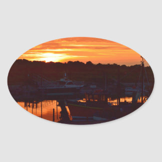 Boats At Sunset Oval Sticker