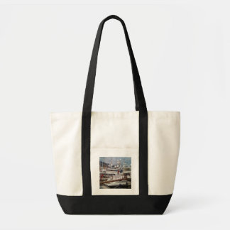 Boats docked tote bags