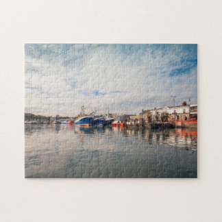 Boats docked between a clouds landscape jigsaw puzzle