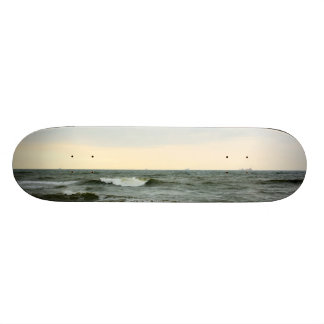 Boats in the sea and waves in the border of the be custom skateboard