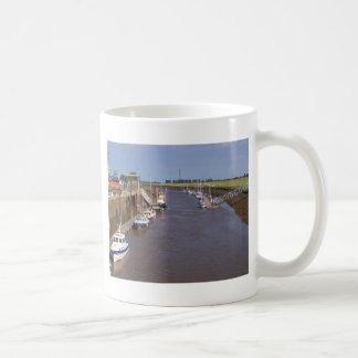 Boats in the sun coffee mug