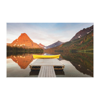 Boats on calm morning at Two Medicine Lake in Canvas Print