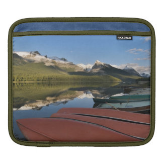 Boats parked on the lakeshore of Maligne Lake, iPad Sleeve