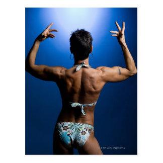 Body builder posing postcard