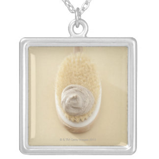 Body scrub brush with bath scrub silver plated necklace