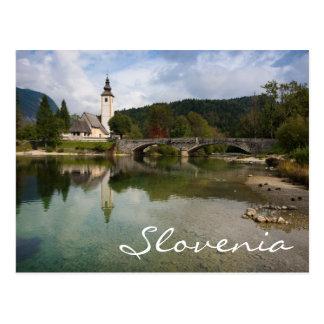 Bohinj lake with church in Slovenia text postcard