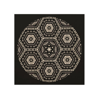 Bold black geometric mandala art on wood