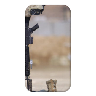 Boots, rifle, dog tags, and protective helmet iPhone 4 cases