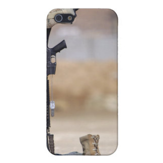 Boots, rifle, dog tags, and protective helmet iPhone 5 covers