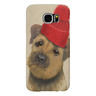 Border Terrier with Red Bobble Hat