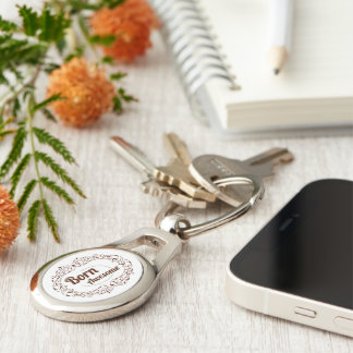 Born Awesome Text Design Ornate Swirls Frame Silver-Colored Oval Key Ring