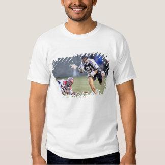 BOSTON, MA - JUNE 4:  Jeff Reynolds #21 2 Tshirts
