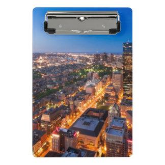 Boston's skyline at dusk mini clipboard