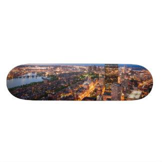 Boston's skyline at dusk skate boards